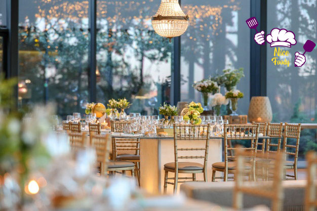 decorated-wedding-hall-with-beautiful-table-setting-with-floral-decorations_181624-6509_copy.jpg